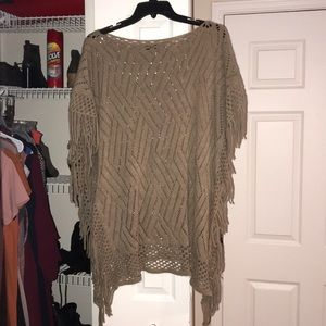 Tan poncho. Like new condition. One size fits all